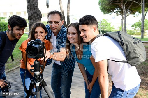 istock group young photography students with teacher during outdoor photo course 595360182