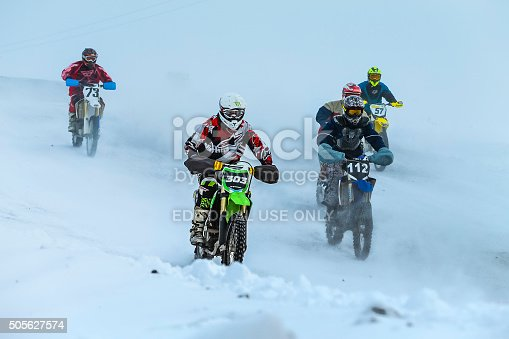 Miasskoe, Russia -  January 16, 2016: group young racers drive on snowy motocross track during Cup of Urals winter motocross