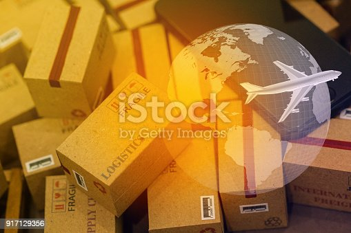 istock grouping Light brown small boxes and cell phone with a plane flies above world map. For ideas about transportation, international freight, global shipping, overseas trade, regional ,local forwarding. 917129356