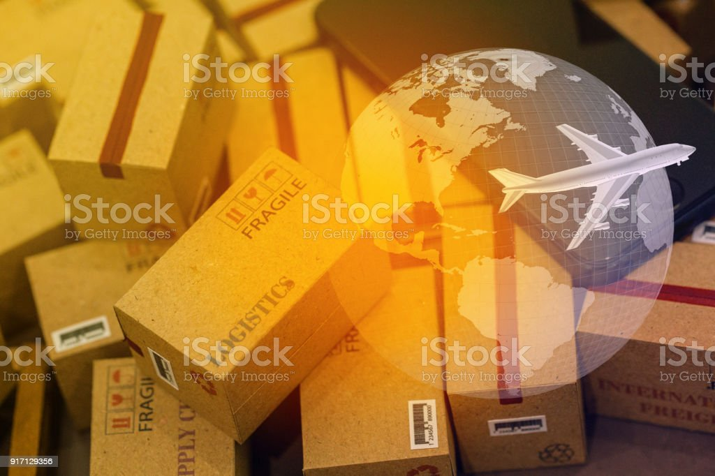 grouping Light brown small boxes and cell phone with a plane flies above world map. For ideas about transportation, international freight, global shipping, overseas trade, regional ,local forwarding. stock photo
