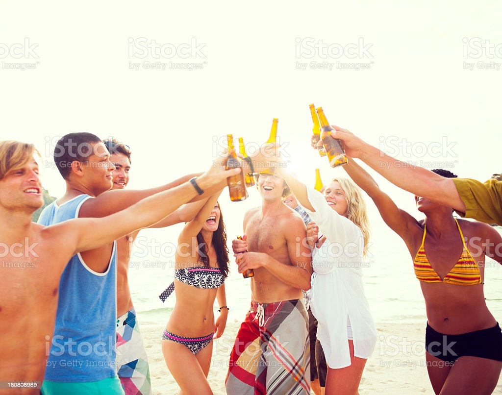 Groups of friends having a party on the beach stock photo