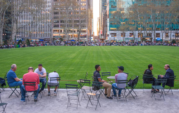 Groups of People Seating by the Bryant Park Lawn at Sunset