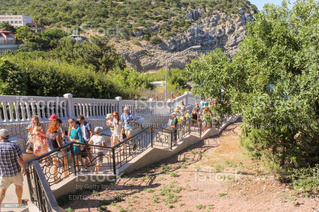 Groups of tourists on the stairs. royalty-free stock photo