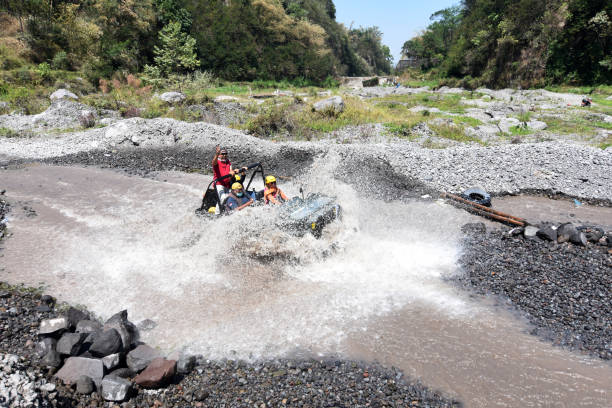 Groups of tourists ride willys jeep to explore the tourist spots of Merapi Yogyakarta, Indonesia - August 25, 2018: Groups of tourists ride willys jeep to explore the tourist spots of Merapi volcanic eruptions in Cangkringan village, Sleman, Yogyakarta, Indonesia willys stock pictures, royalty-free photos & images