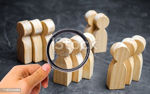 istock Groups of wooden people. The concept of market segmentation. Marketing segmentation, target audience, customer care. Market group of buyers. Customer analysis and customer relationship management 1132234494