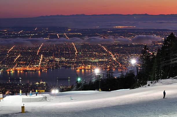 Grouse Mountain Night Ski Runs and Downtown Vancouver stock photo