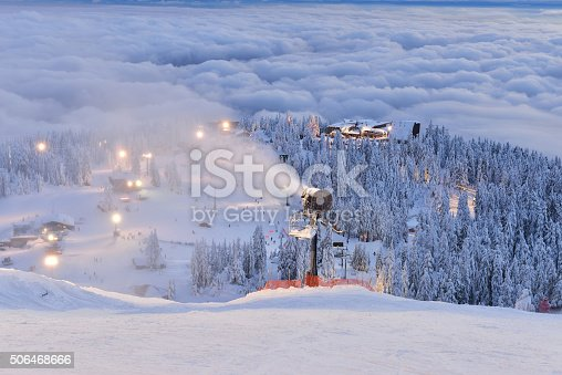 Grouse Mountain Ski Hill with foggy cityscape beneath at sunset, Vancouver, BC