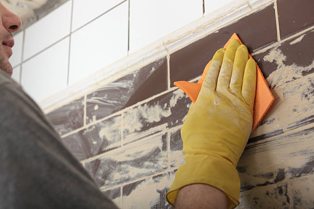 Grouting ceramic tiles stock photo