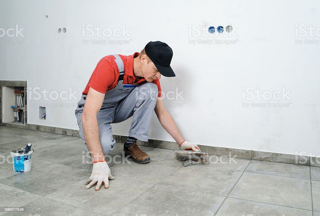 Grouting Ceramic Tiles Stock Photo More Pictures Of Cement Istock