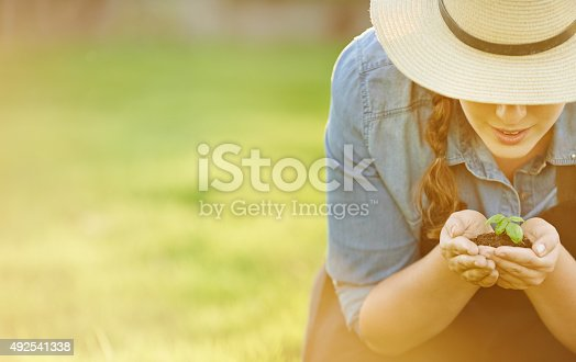 Cropped shot of a woman holding a handful of soil with a budding planthttp://195.154.178.81/DATA/i_collage/pu/shoots/805735.jpg