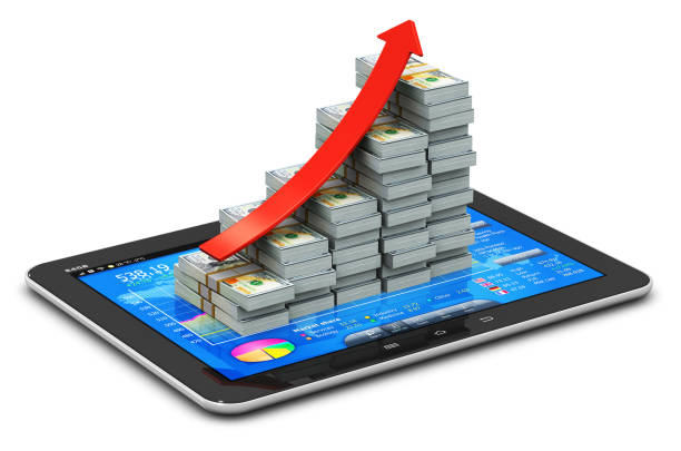 Growing bar graph from US dollars on tablet with stock exchange app stock photo