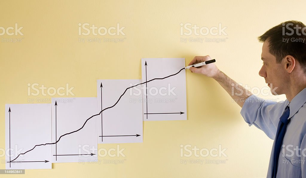 Growing business chart drawn manually by hand businessman drawing chart indicating success in business Adult Stock Photo