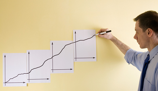 Growing Business Chart Drawn Manually By Hand Stock Photo - Download Image Now