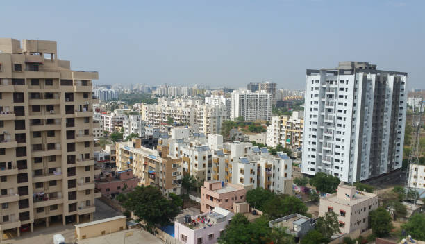 Growing cities in India Concrete buildings showing growing cities in Asian developing countries bangalore stock pictures, royalty-free photos & images