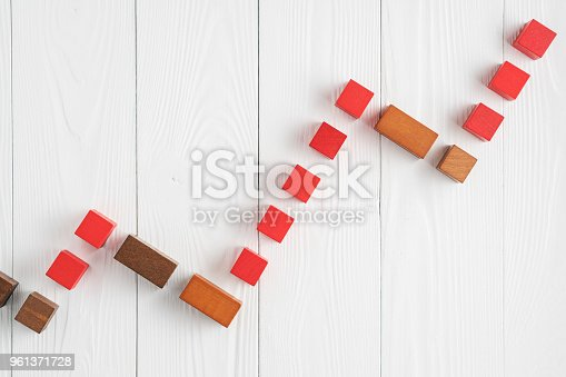 istock Growing graph from wooden blocks. 961371728