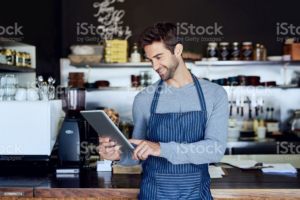 Growing his business with technology stock photo