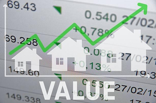 Growing housing market. Uptrend arrow. stock photo