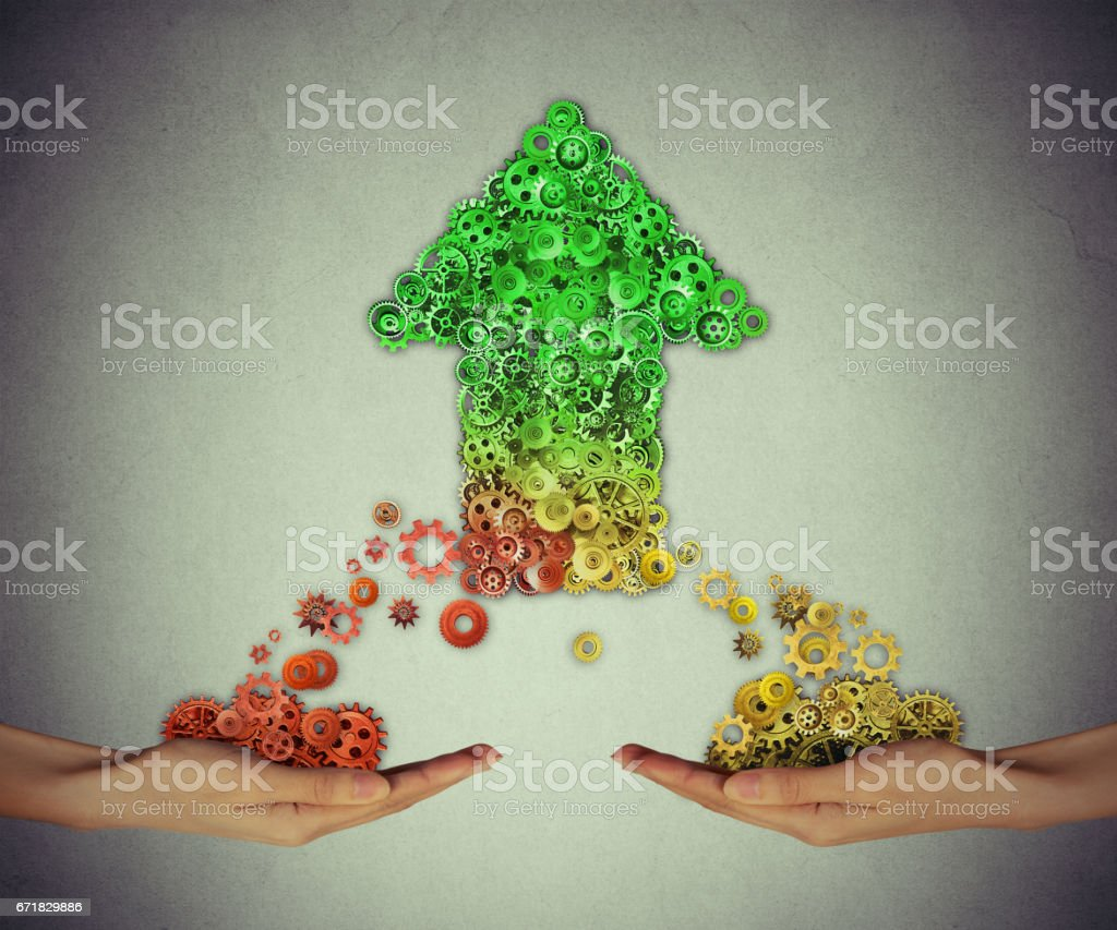 Growing industry success concept. Group of gears and cogs coming together to form shape of an upward arrow stock photo
