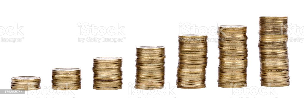 Growing Stacks of Golden Coins stock photo