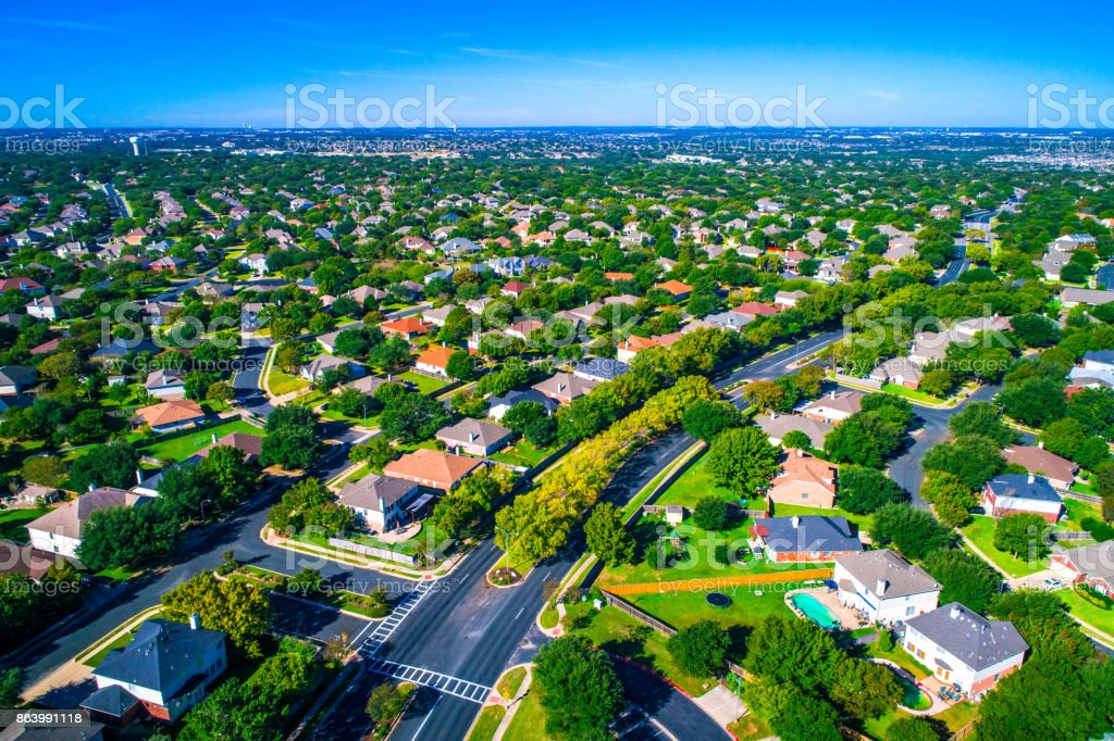 Growing suburban town Round Rock , Texas , USA aerial drone view high above Suburb Neighborhood with Vast amount of Homes stock photo