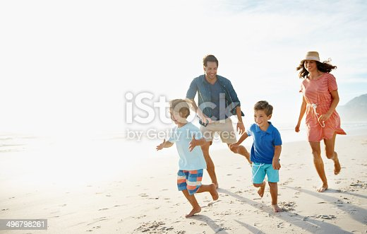 Shot of a young family playing together on a sunny beachhttp://195.154.178.81/DATA/i_collage/pu/shoots/784348.jpg