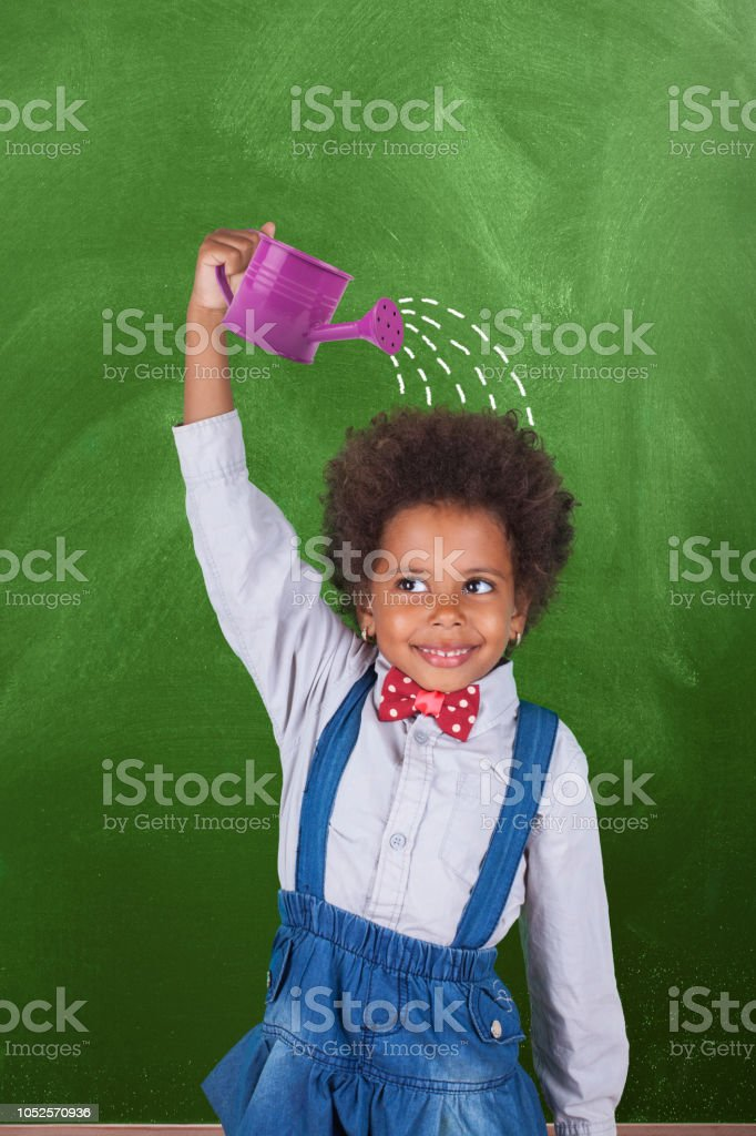 Growing up in front blackboard stock photo