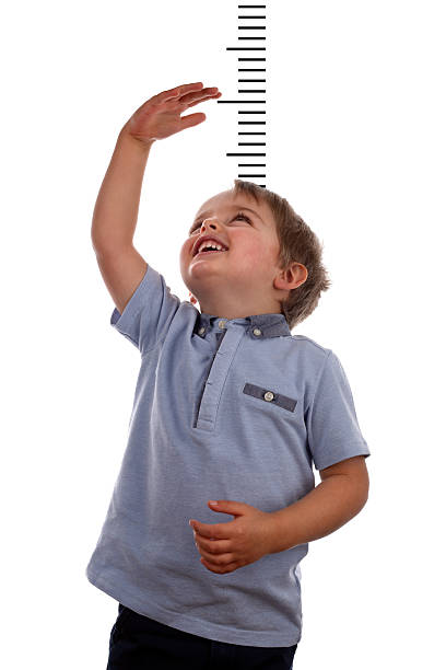 growing up - height measurement stock photos and pictures