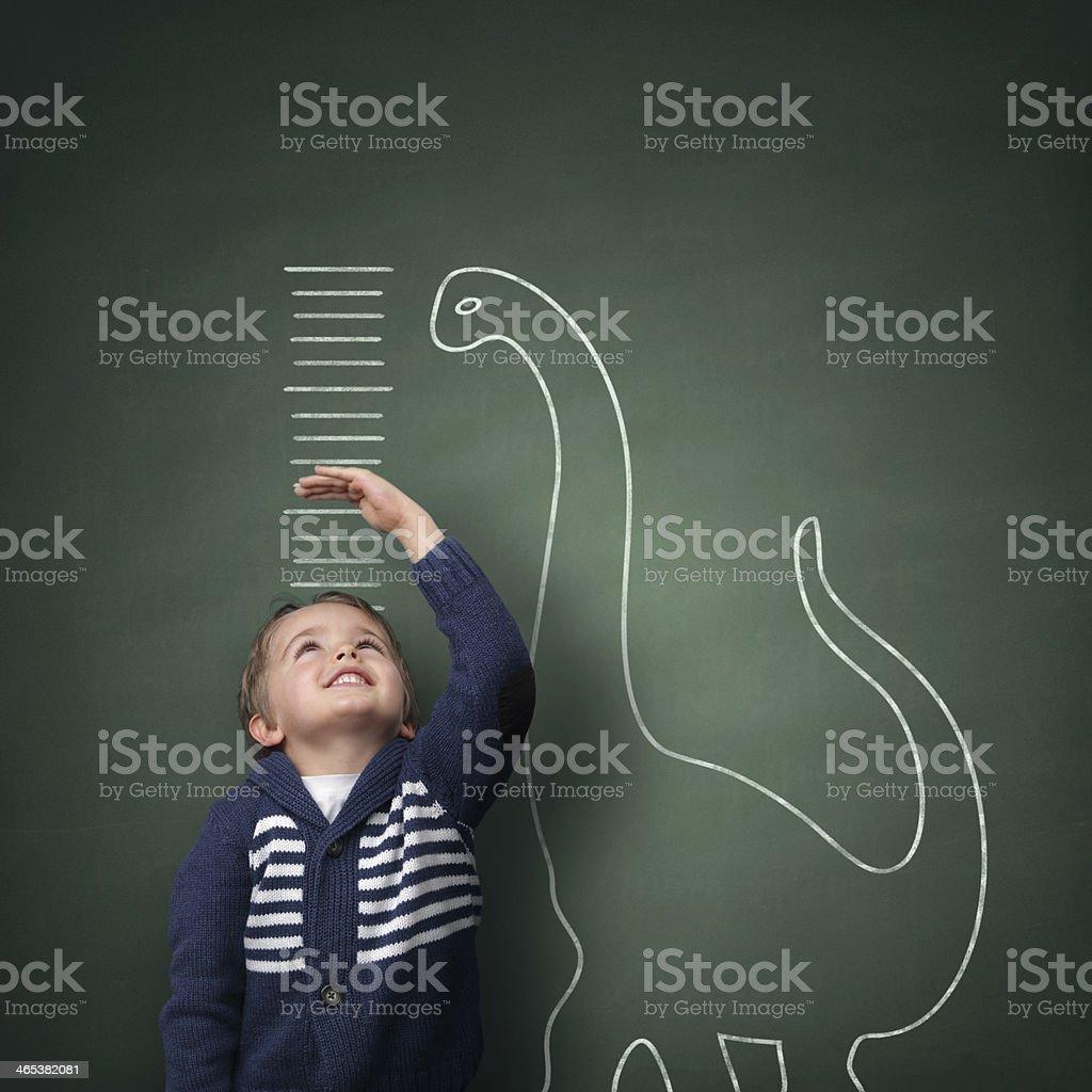 Growing up taller than a dinosaur stock photo