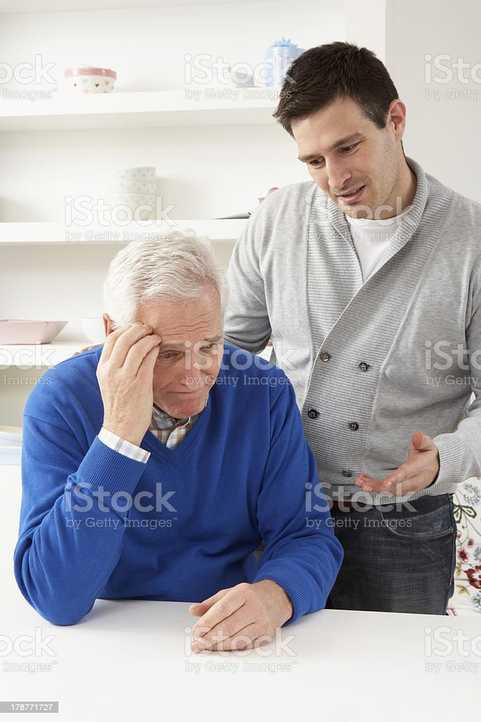 Grown Up Son Consoling Senior Parent royalty-free stock photo