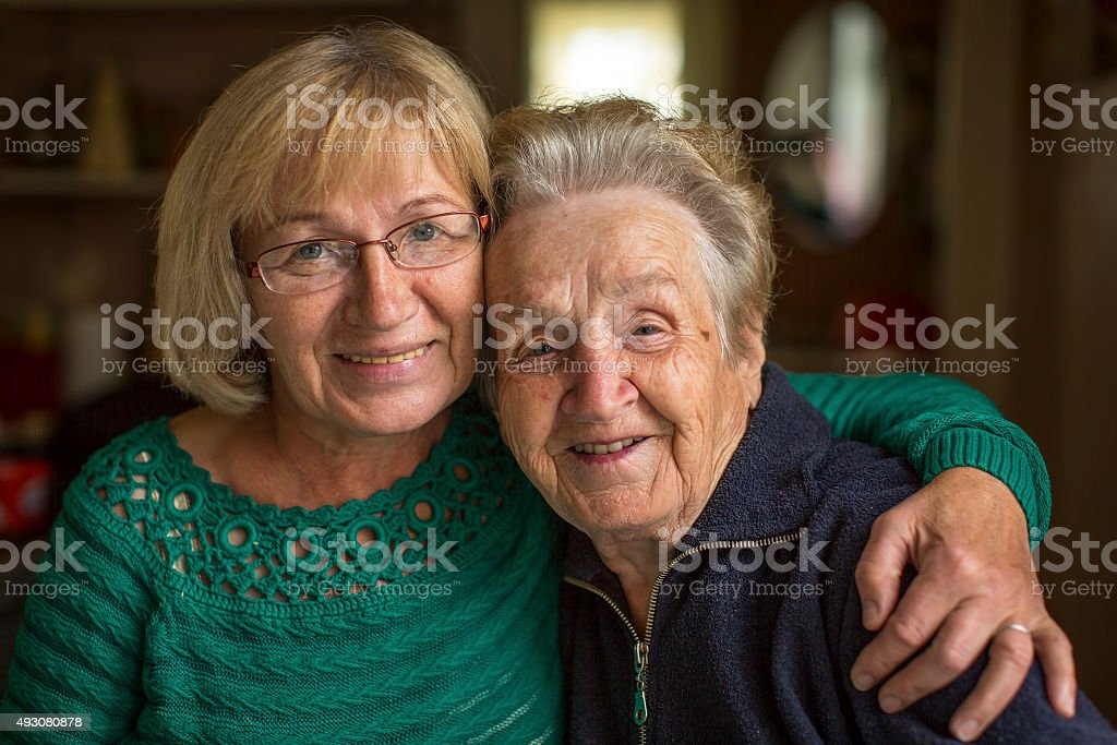 Grown woman with her old mother. stock photo