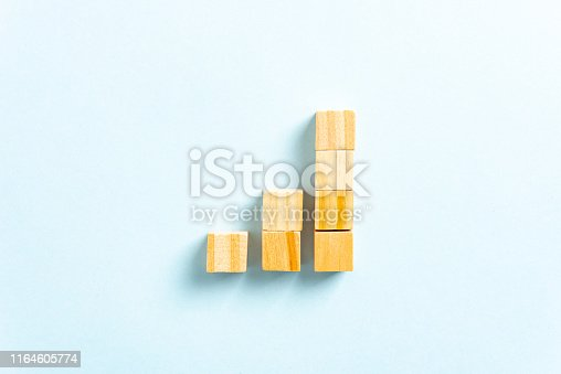 istock Growth Bar Chart Graph Diagram with wooden block toys on blue background. Successful Business concept. 1164605774