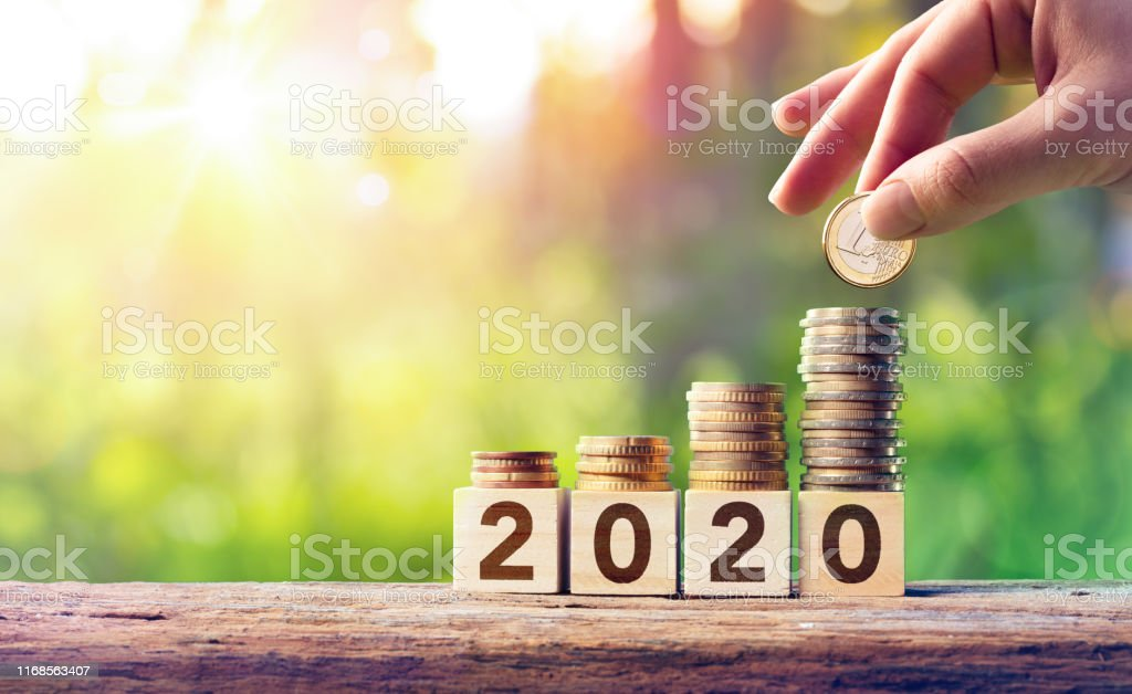 Growth Forecast Concept For 2020 - Coins Stack On Wooden Blocks Growth Forecast Concept For 2020 - Coins Stack On Wooden Blocks 2020 Stock Photo
