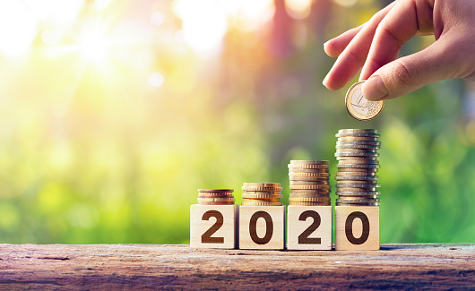 Growth Forecast Concept For 2020 Coins Stack On Wooden Blocks Stock Photo - Download Image Now