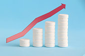 istock Growth graph made of stacked white pills 1212489960