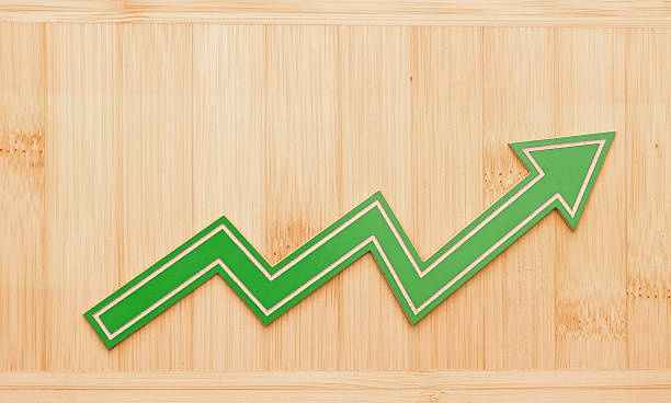 Growth graph on wooden wall stock photo