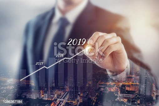 istock Growth in 2019 year concept. Businessman plan growth and increase of positive indicators with city background, Double exposure. 1086367184