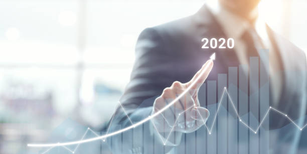 Growth success in 2020 concept. Businessman plan and increase of positive indicators in his business. Growth success in 2020 concept. Businessman plan and increase of positive indicators in his business. modern period stock pictures, royalty-free photos & images