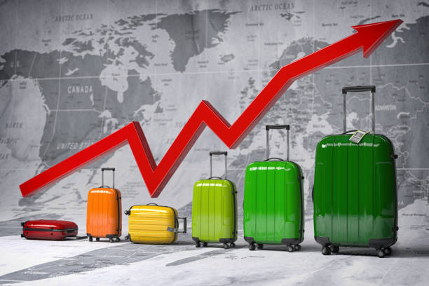 Growth travel and tourism industry. Graph and diagram from suitcases on the map of world. stock photo