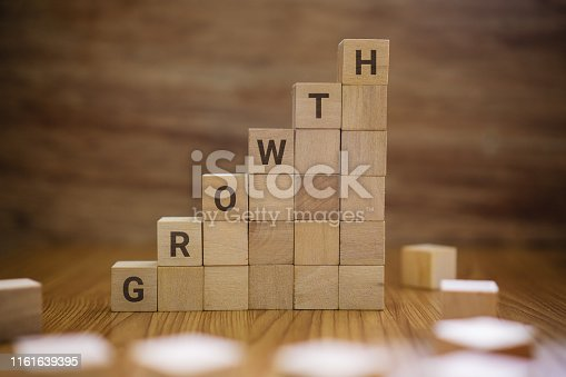 Growth word on wooden blocks staircase.