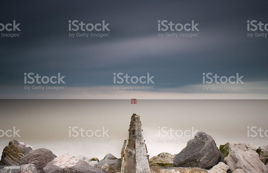 Groynes and rock armour, Aldeburgh, Suffolk stock photo