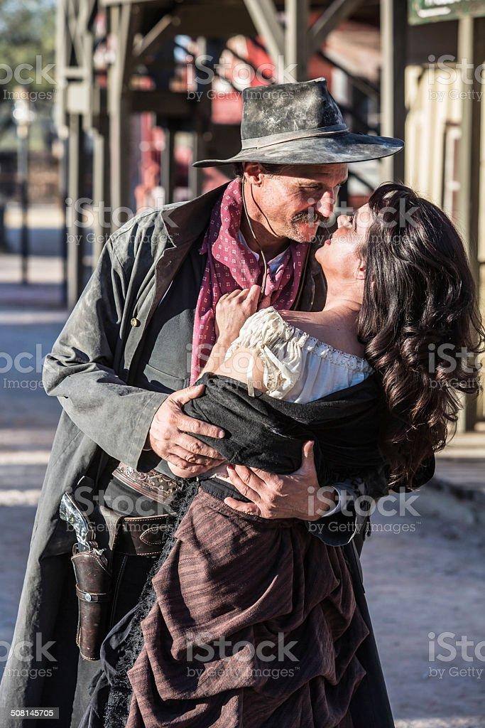 Gruff Man and Woman Kiss stock photo