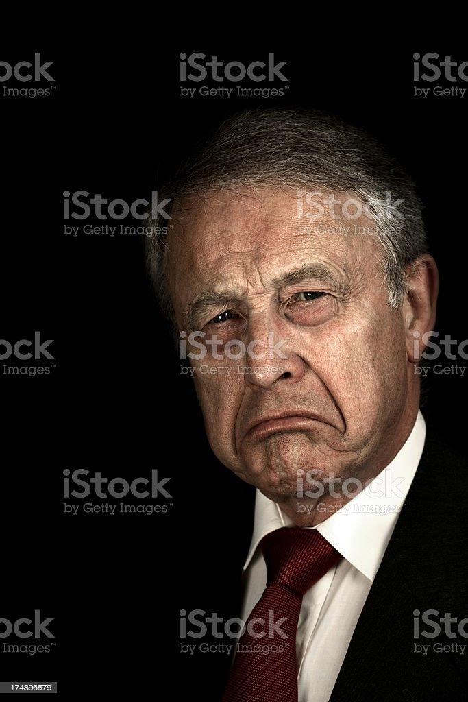 Grumpy businessman stock photo