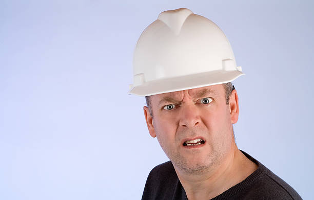 Grumpy Construction Worker stock photo