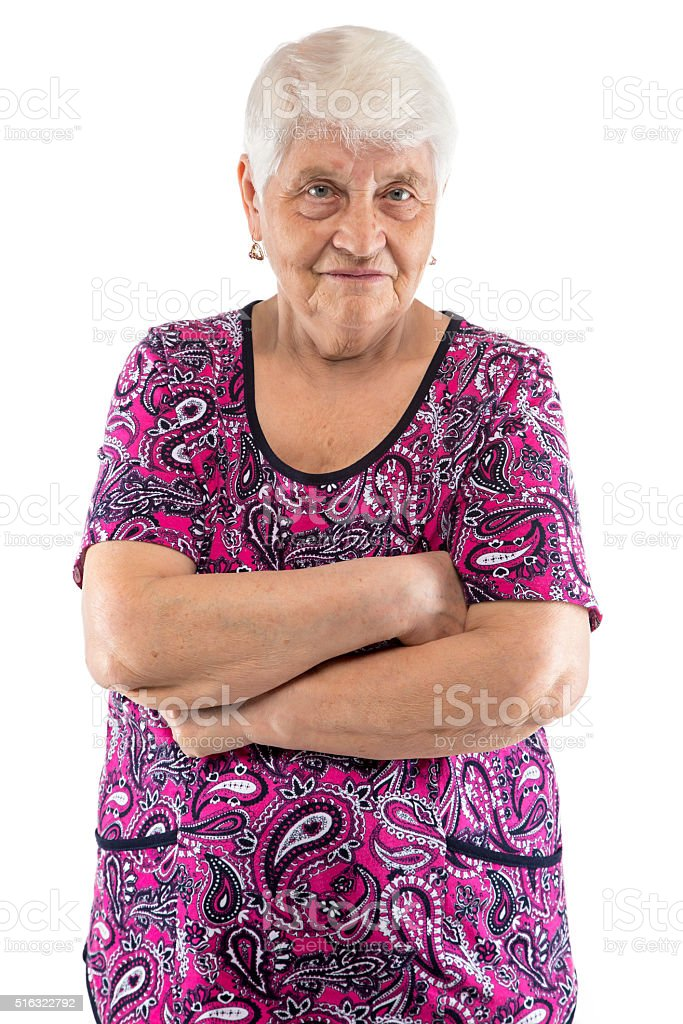 Grumpy elderly lady with arms crossed stock photo
