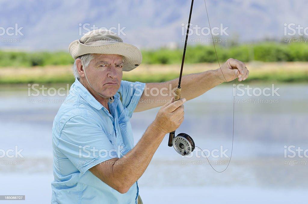 Grumpy fisherman stock photo