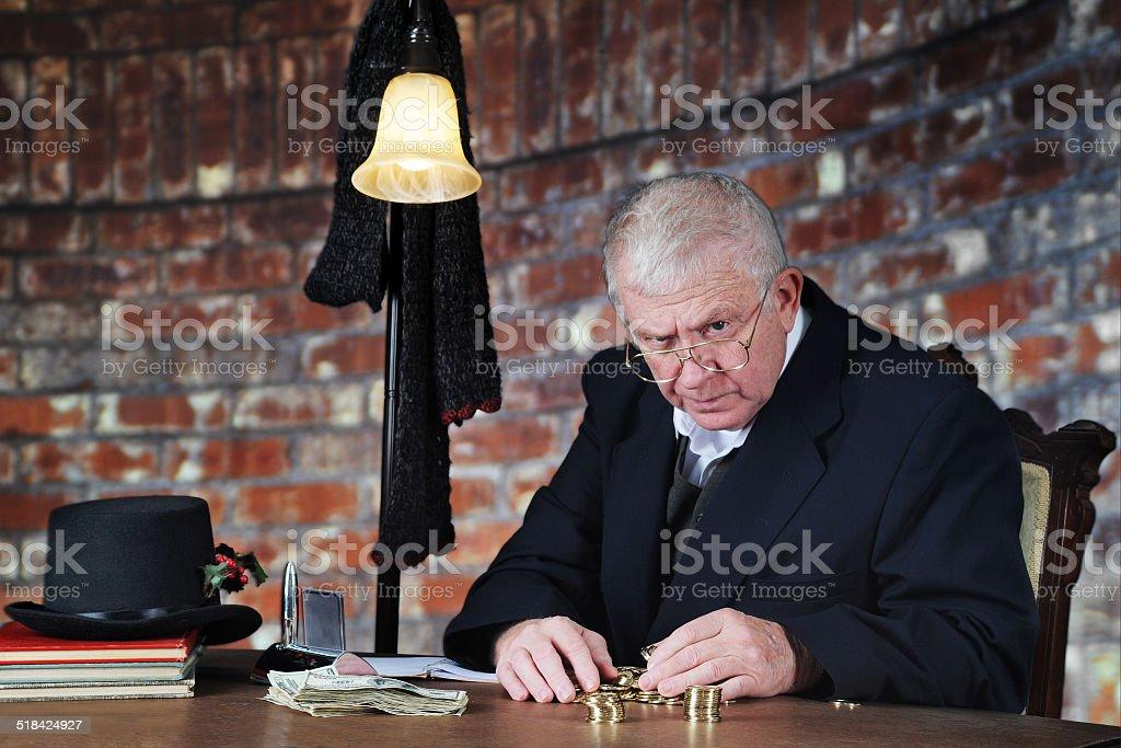 Grumpy Money-Counter stock photo