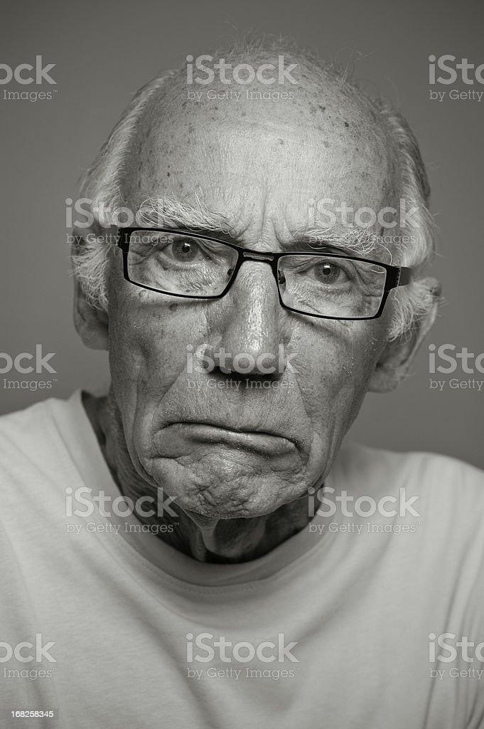 Grumpy Old Man in Monochrome stock photo