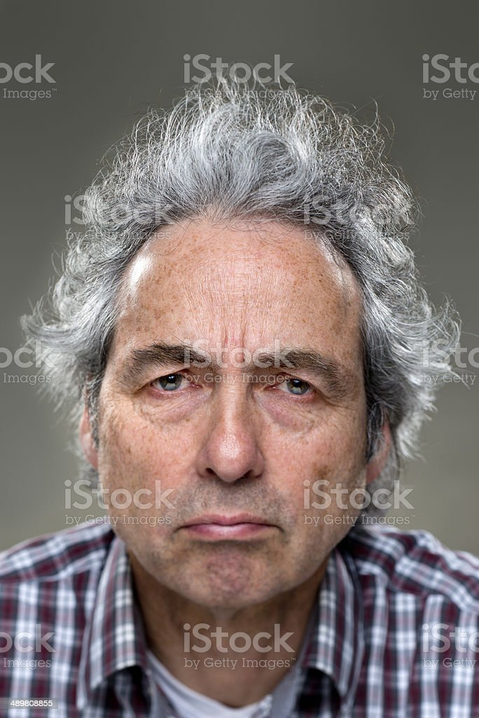 Grumpy Real man stock photo