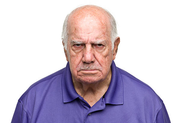 Grumpy Senior Man Portrait of a senior man on a white background. http://s3.amazonaws.com/drbimages/m/rl.jpg agitation stock pictures, royalty-free photos & images