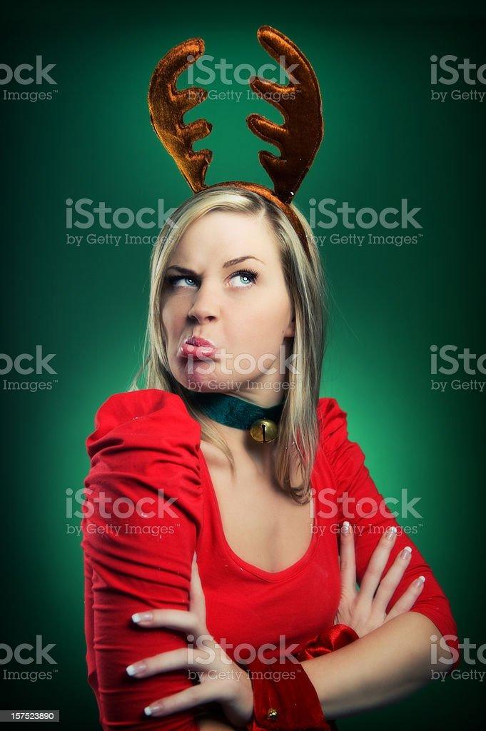 grumpy woman in reindeer costume christmas time royalty-free stock photo